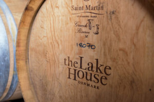 Age wine in oak barrels