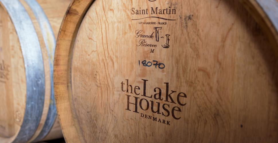 Age wine in oak barrels